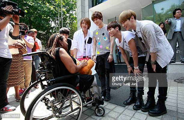 Year old American girl Donica Streling meets with members of SHINee and Super Junior at SM Entertainment head office on June 20, 2012 in Seoul, South...