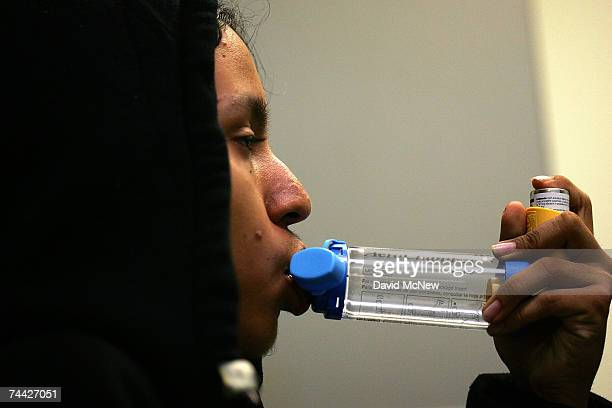15yearold Jesus Ayala learns the proper use of the new albuterol sulphate inhaler through a holding chamber at the Venice Family Clinic on June 6...