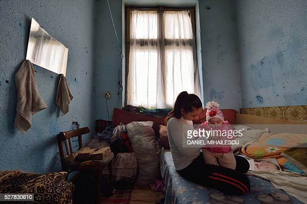 Year-old Lorena holds her child at her home in an abandoned building where another few families live in a village near Botosani, north-eastern...