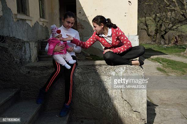 Year-old Lorena holds her child s she speaks with a friend at her home in an abandoned building where another few families live in a village near...