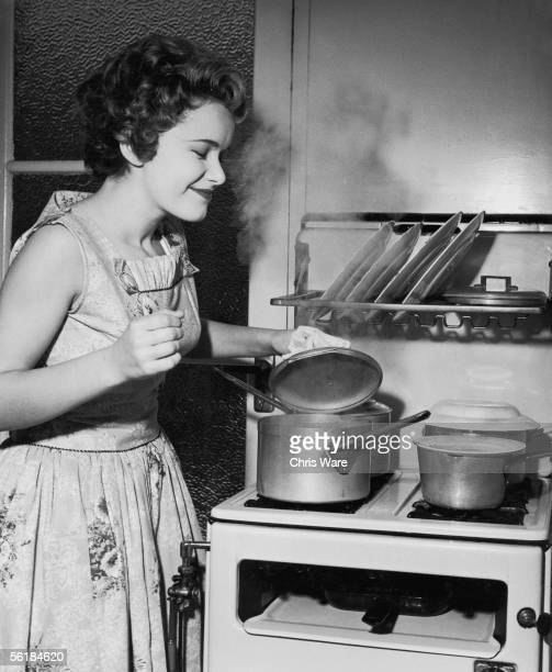 15yearold singer Jill Westlake seems pleased with the results of her culinary endeavours at her home in WestgateonSea Kent September 1958