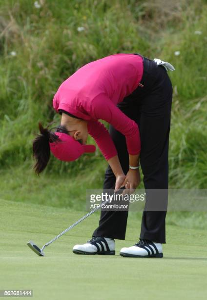 15yearold US player Michelle Wie hangs her head after missing a putt on the 6th hole on the fourth day of the Women's British Open Golf at Royal...