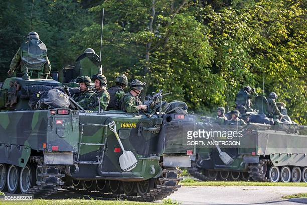 A 160man combat team from Skaraborg Armoured Regiment deploy in Visby harbour in Sweden on September 14 2016 Sweden's Baltic Sea island of Gotland is...
