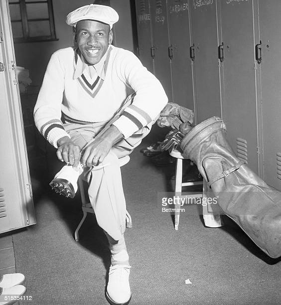 Los Angeles, CA- Bill Spiller, the first Negro to compete in any major golf tournament, puts on his shoes in the locker room of the Riviera country...