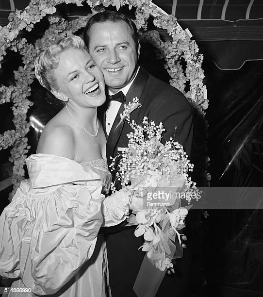 1/6/1953West Los Angeles CA Songstress Peggy Lee embraces her husband actor Brad Dexter after their wedding at the bride's home in West Los Angeles...
