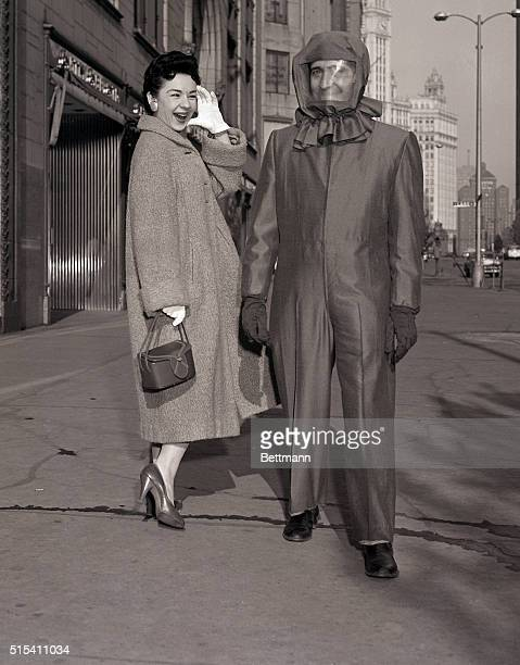 1/6/1956Chicago IL An atomic age outfit a suit designed to protect the wearer from Hbomb fallout gives a big laugh to Loraine Hayducak in Chicago The...