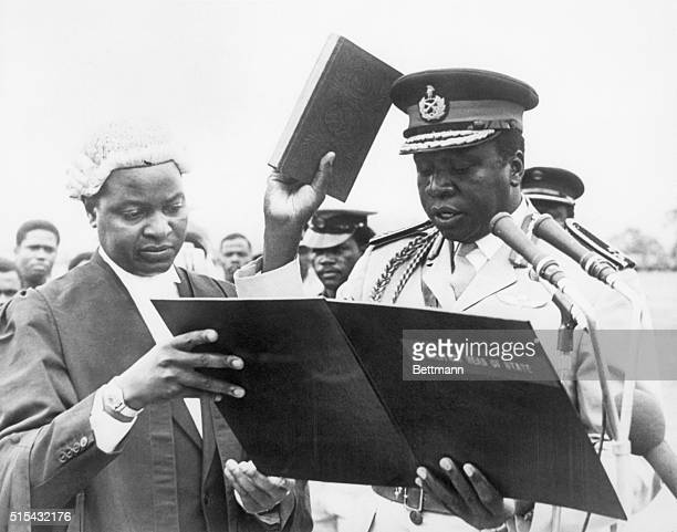Kampala, Uganda- Major-General Idi Amin, the leader of last month's successful military coup, takes the oath of office under the supervision of Chief...