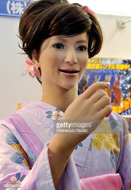 A 165cm tall humanoid robot 'Actroid' wearing a Kimono dress and produced by Japanese robot maker Kokoro gestures at Sanrio's headquarters in Tokyo...