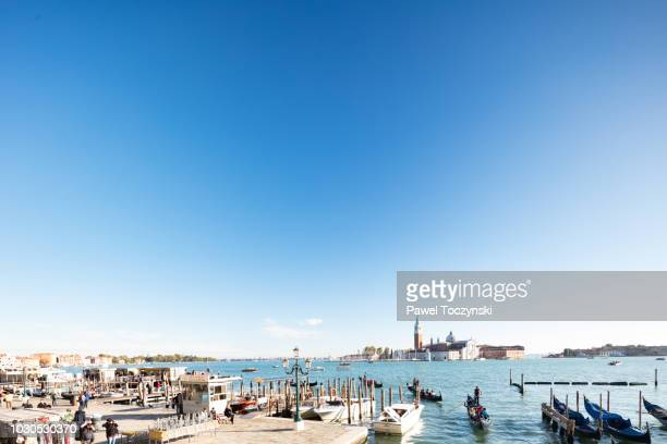 16-century san giorgio maggiore church on the island off venice's st mark's square, italy - gondola traditional boat stock pictures, royalty-free photos & images