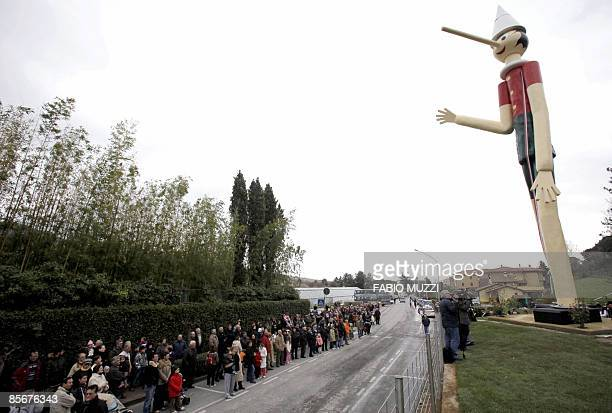 A 16metretall statue of fictional fibprone puppet Pinocchio is seen from a street in the Italian village of Collodi on March 28 2009 The Guinness...