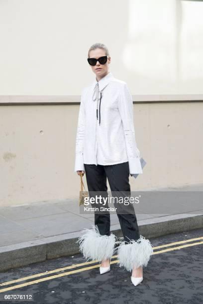 TFashion designer Federica Cavenati wears all 16Arlington with Celine sunglasses and Manolo Blahnik shoes on day 4 of London Womens Fashion Week...