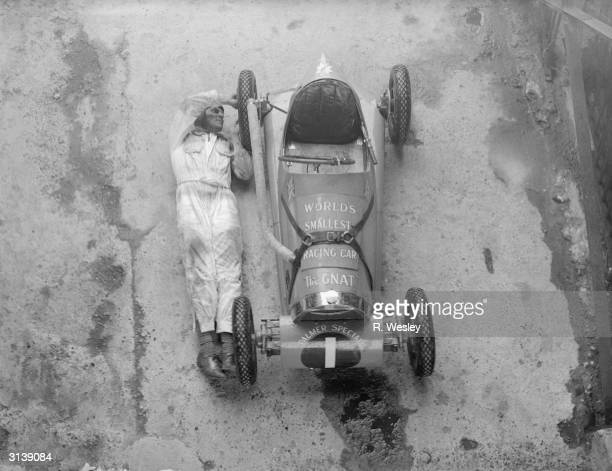 The length of an adult male Jean Reville's midget car 'the gnat' being given an overhaul by a mechanic in preparation for a Jubilee meeting being...