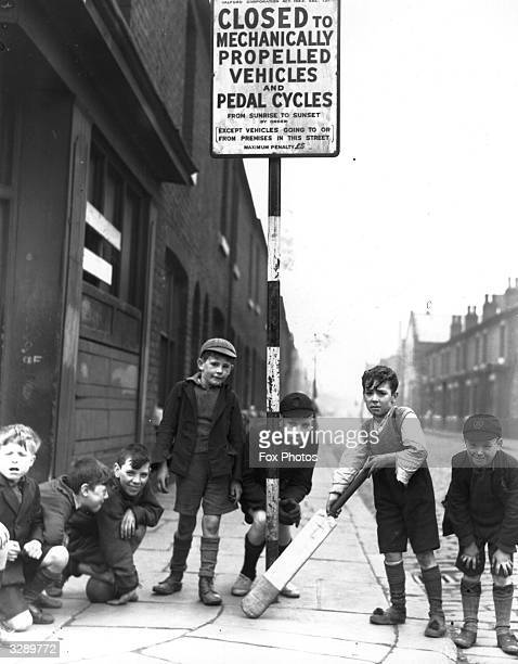 Children playing cricket in Salford in a street that has been closed to vehicular traffic