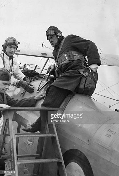 British statesman Winston Churchill recently appointed Hon Air Commodore to 615 Auxiliary Air Force Squadron climbing out of a Gloster Gauntlet II...