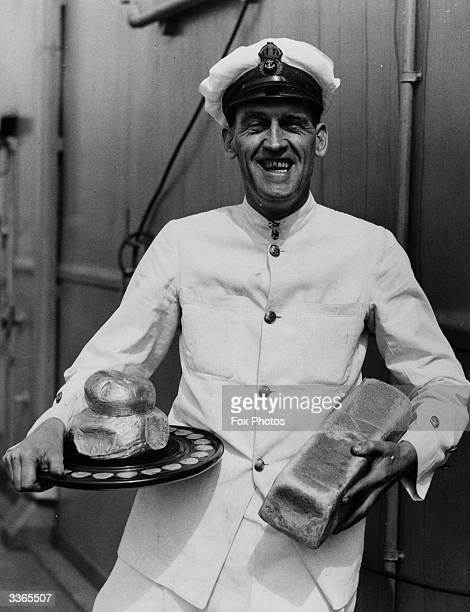 Chief petty officer cook RAW King holding a silver loaf award aboard the new aircraft carrier 'Ark Royal' He has won the Challenge Silver Loaf making...
