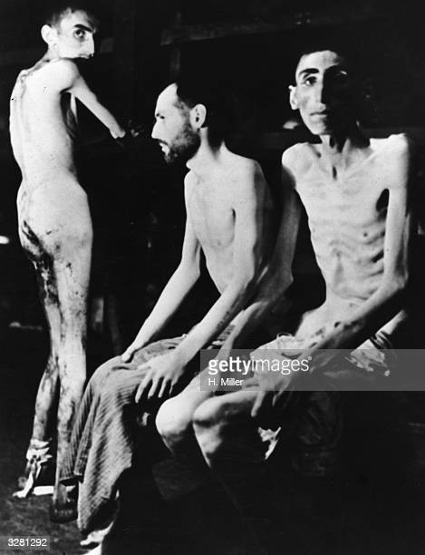 Starving Russian Polish and Dutch slave labourers after 11 months at the Buchenwald concentration camp found when US troops liberated the camp in 1945
