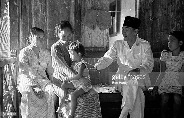 Indonesian president Achmed Soekarno greeting people on the island of Banka where he has been detained by the Dutch authorities Original Publication...