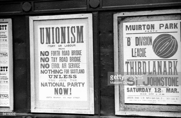 Posters for the Scottish National Party and a football match Third Lanark versus St Johnstone vie for attention on a wall in Perth the 'Fair City'...