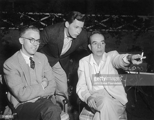 Film director Vincente Minnelli on the set of 'Tea and Sympathy' with screenwriter Robert Anderson and actor John Kerr