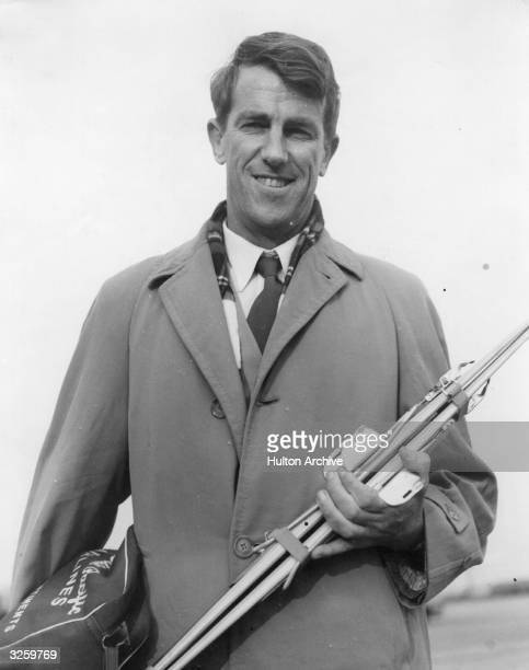Sir Edmund Hillary the Everest climber at London Airport about to leave for New Zealand He is taking a small pair of skis for his son