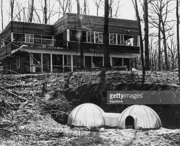 A twounit fallout shelter of the kind recommended by the US Civil Defence Office being constructed by Adam Yarmolinsky special assistant to the...