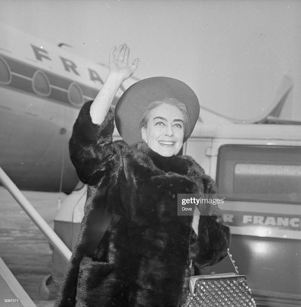 American Actress Joan Crawford Waving To Photographers At