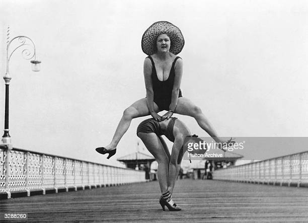 Holidaymakers enjoying a game of leapfrog on the pier at Llandudno