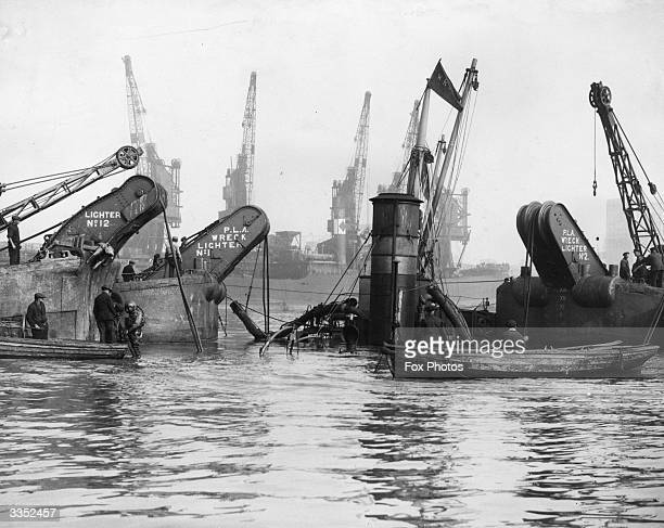 The Port Of London Authority at work attempting to lift the 460 ton steamer 'Cragside' after a collision with the 9032 ton British India liner...