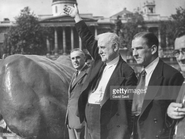 Former Labour party leader George Lansbury addresses the crowd at a demonstration against the Unemployment Assistance Regulations in Trafalgar Square...