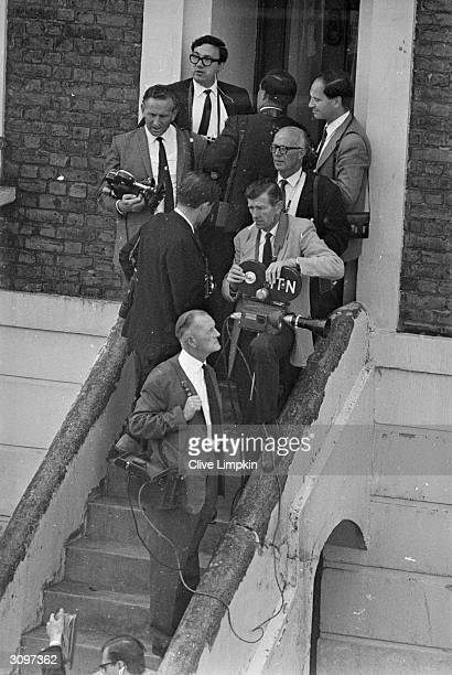 Press photographers wait outside a West London Court to catch a glimpse of John Edward Witney who with Harry Roberts and John Duddy is being remanded...