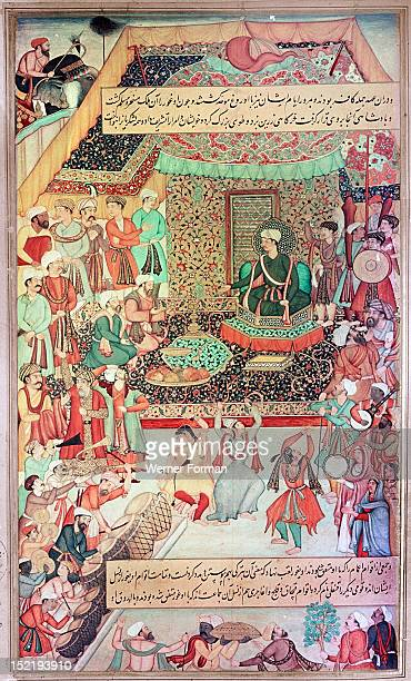 16th century illustration of a 14th century Persian story The History of the Mongols, King Oghuz on his throne in the gold tent celebrates his...