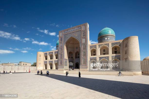 16th century miri-arab madrasah in bukhara, uzbekistan, 2019 - trading_post stock pictures, royalty-free photos & images