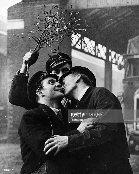 Two porters get a bit of practise in for Christmas when a large consignment of mistletoe arrives at the Southern Railway's Nine Elms depot for...