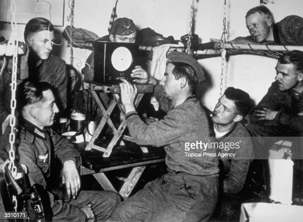 German soldiers tuning their radio in their underground quarters on the Siegfried Line