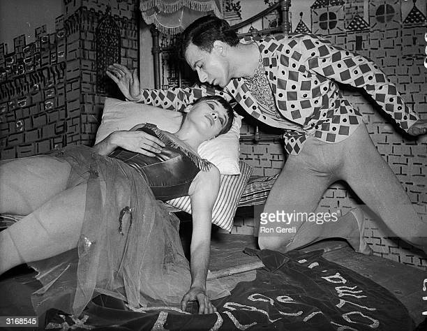 French actress and dancer Leslie Caron as the Sleeping Beauty with Roland Petit in a production of 'La Belle au Bois Dormant' Petit also...