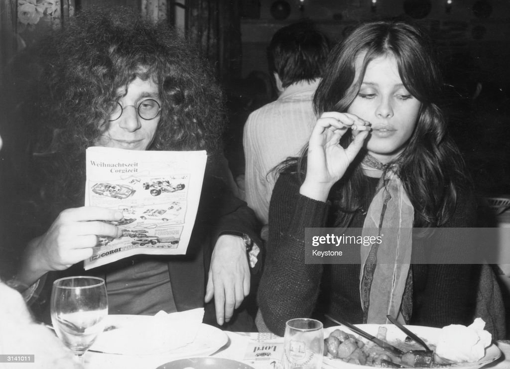 Rainer Langhans and his girlfriend Uschi Obermaier in a Munich restaurant. Two of the founders of the Berlin Commune 1 which was eventually unsuccessful, they are in Munich to try and start a similar venture.
