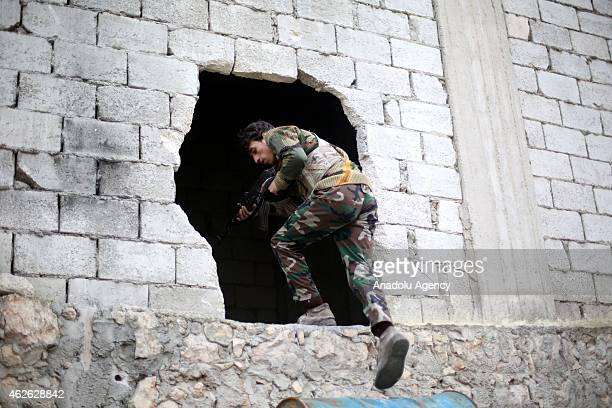 A 16th division member of Free Syrian Army is seen during the attacks against Assad regime forces in Ashrafieh district of Aleppo Syria on January 31...