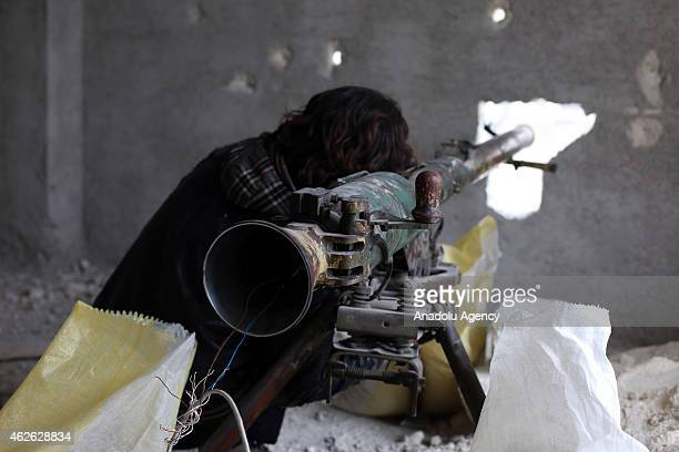 A 16th division member of Free Syrian Army make preparations with an antitank missile during the attacks against Assad regime forces in Ashrafieh...