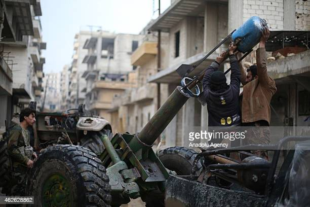 16th division members of Free Syrian Army stage attacks with howitzers, made up by propane cylinder and named 'hell', against Assad regime forces in...