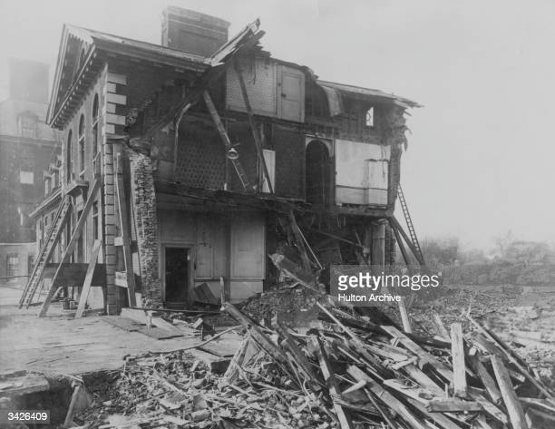 The ruins of the North East wing of Chelsea Hospital London bombed by a German airforce Zeppelin An officer of the hospital staff his wife her sister...