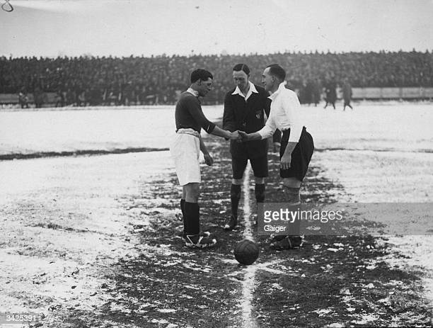 Swindon captain Dickenson shaking hands with Arsenal FC captain Tom Parker before an FA Cup fifth round tie at Swindon