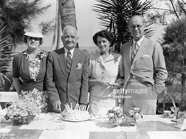John F Fitzgerald cuts a cake on his 77th birthday next to his wife Mary , his daughter, Rose Kennedy , and her husband, American financier Joseph...