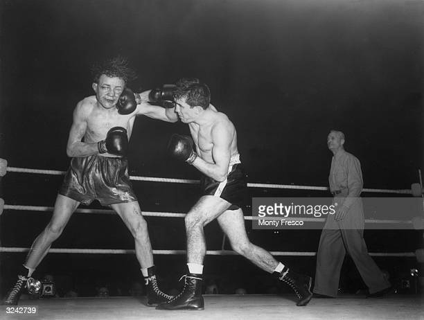 Sammy McCarthy takes a punch from Belgian boxer Jean Sneyers during their European featherweight title fight at Harringey Arena
