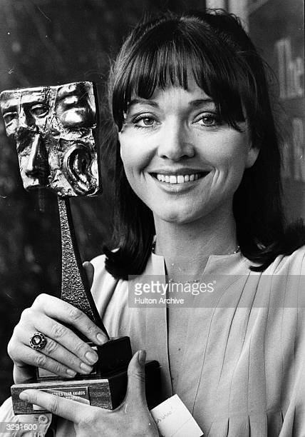 British newscaster Anna Ford, the first woman to read the news on ITN's 'News at Ten', with an award.