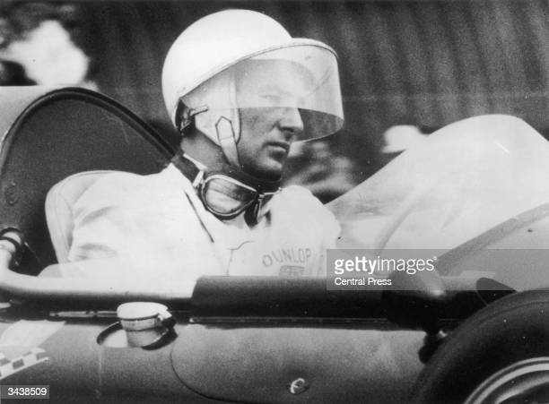British racing driver Stirling Moss at the wheel of his Cooper T45 Climax during the final of the New Zealand Grand Prix at the Ardmore circuit in...