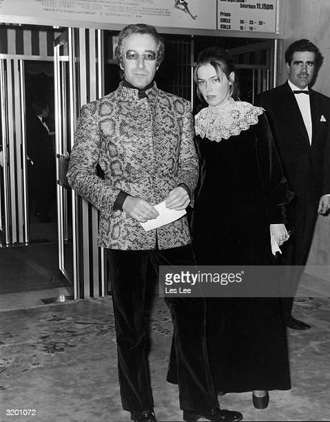 Fulllength image of British actor and comedian Peter Sellers and his future wife Miranda Quarry attending the premiere of director William Wyler's...