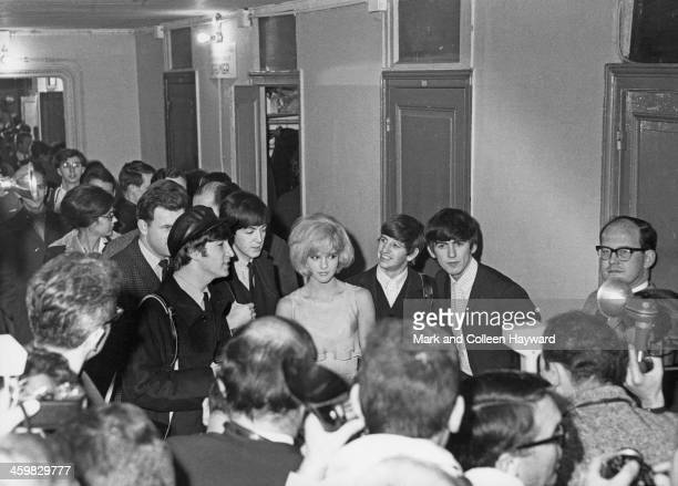 John Lennon Paul McCartney Ringo Starr and George Harrison from the Beatles pose with French singer Sylvie Vartan at Olympia in Paris on 16th January...