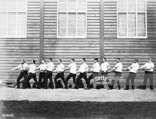 1st Battalion Grenadier Guards tugofwar Champion Team at the Curragh Barracks in County Kildare Sergeant Walls is the first man on the left