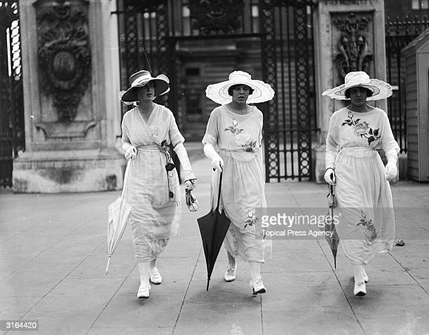 Three little maids arrive at Buckingham Palace in London for a garden party