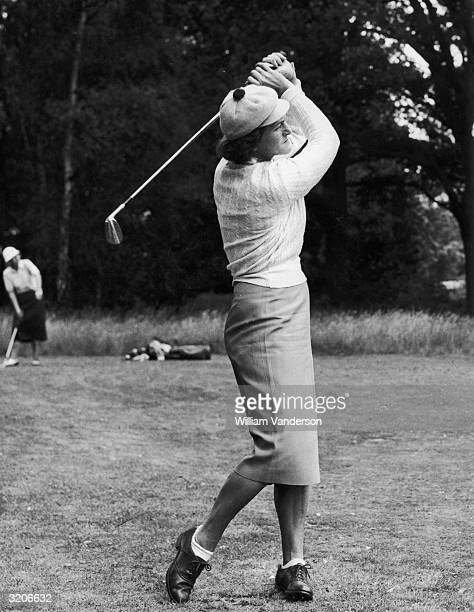 American professional golfer Babe Zaharias drives off during the open tournament at Wentworth Professionals partnered amateurs for the first time...